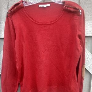 Cleo, rust colored sweater